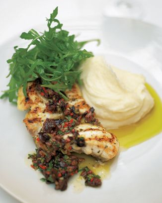 jamie oliver's grilled or roasted monkfish with black olive sauce and lemon mash.