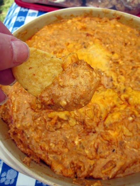 Chili cheese dip 15 oz can chili with no beans 4 oz cream cheese, softened 1 cup grated cheddar cheese 1 clove of garlic - crushed 1 tsp chili powder or southwestern seasoning  Mix together and put in small baking dish. Bake @ 350 for 20 -25 minutes, or until bubbly. Serve with Fritos.