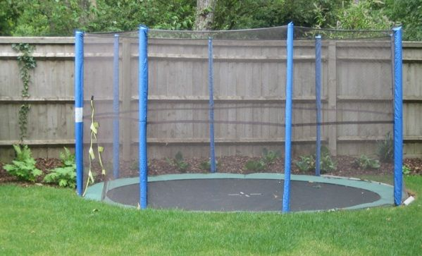 A sunken trampoline - so cool, I think my kids would just about die of excitement.
