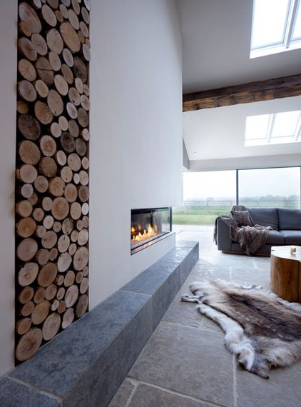 """10 Inspiring Ways to Work Scandi Style""  'Go big on natural materials Wood, stone, slate and animal hides are staples of the Scandi look, and it pays to use them with confidence. Here, a barn conversion has a statement wall of logs, ready for the fire, and a dramatic floor laid with oversized stone slabs.'"