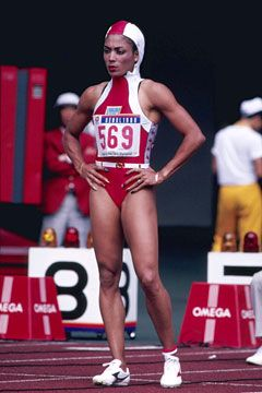 """jesjournal: It seemed that Flo-Jo never ran without her makeup on, her hair done, and her long fingernails pristinely manicured. We can't blame her, as such grooming only boosted her popularity. I'm thinking that it boosted her times on the track as well…        A wise man once said, """"You look good, you perform better,"""" and it's my guess that Florence Griffith-Joyner ripped that page out of the fashion book."""