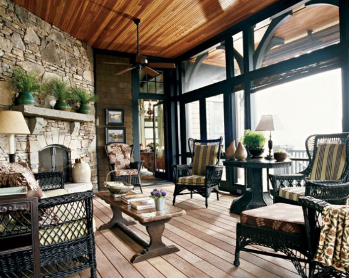 Amelia Handegan porch in South Carolina. The dark wicker, the black trim, that wonderful stone fireplace, the wood ceiling...