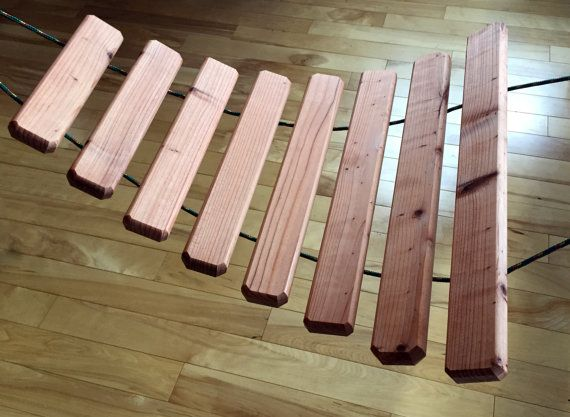 These Large Xylophones are made of Natural Reclaimed Redwood Lumber and are READY TO SHIP!  It measures about 30 inches long and 24 inches at the widest point. 2 mallets and rope to hang it are included.  The tuning is not pitch perfect, but ranges in tones low to high. The xylophone can be used in a variety of places. It can be hung on a deck corner from rail to rail, between trees, indoors on hooks in a corner or vertical on the wall. The best sound is when hung horizontally. This is…