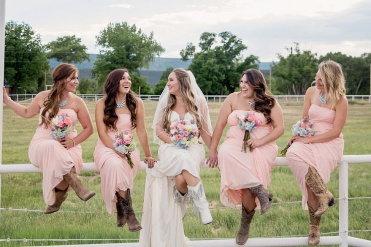 Bridal and bridesmaids in cowboy boots for a country wedding!
