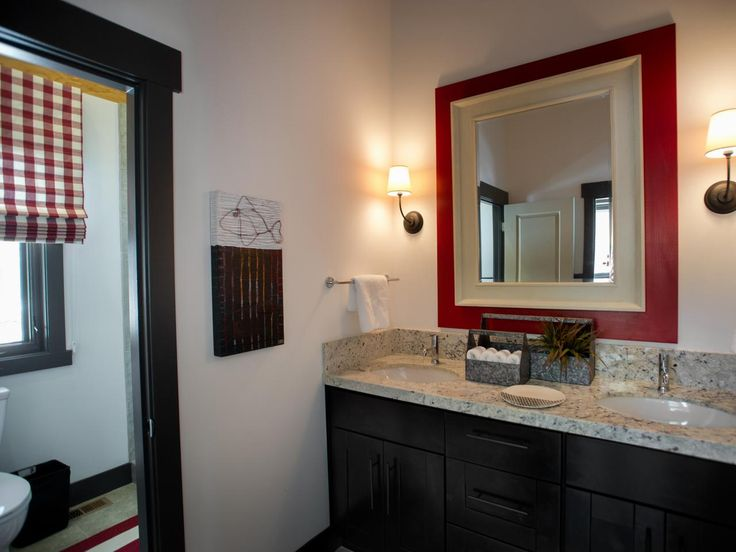 Since the adjacent bunkroom sleeps up to four, this bathroom is built to accommodate a crowd. It features two zones: A vanity and dressing area and a separate commode and shower area.
