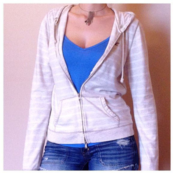 Tan & Cream Zip Up Hoodie Gently used Cream & White Zip Up Hoodie. Distressed style on hems. 85% cotton, 11% polyester, 4% elastane. No rips. No stains. Hollister Tops Sweatshirts & Hoodies