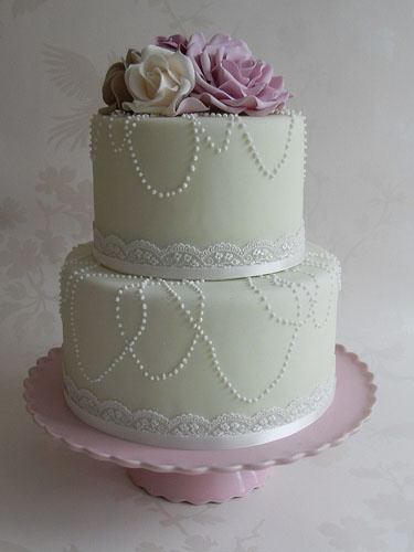 Mint green two-tiered with pearls, flowers and lace.