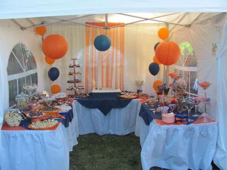 orange and blue graduation dessert candy buffet table