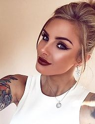 Winged eyeliner & dark red lips with your hair up!
