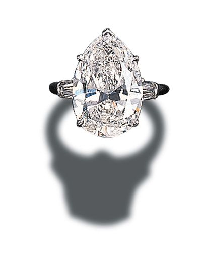 A SINGLE-STONE DIAMOND RING, BY HARRY WINSTON Set with a pear-shaped diamond weighing 5.05 carats to the tapered baguette-cut diamond shoulders and platinum hoop With jeweller's mark for Harry Winston 5.05 carats