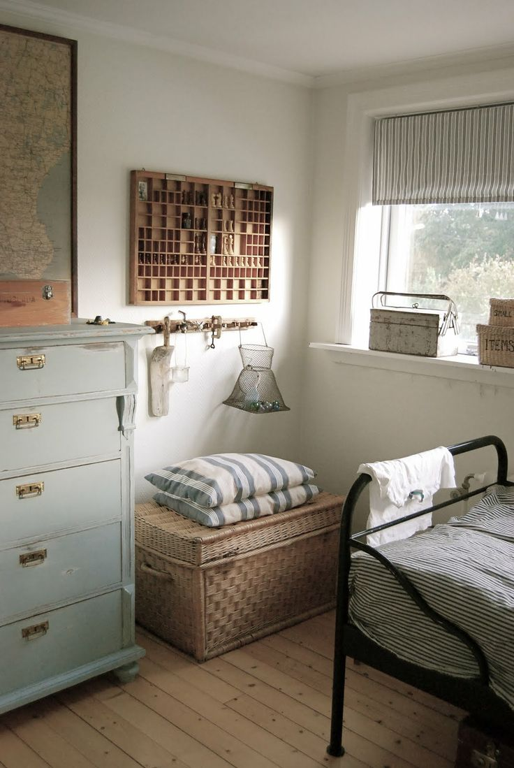blue white and natural bedroom - love the printing press storage