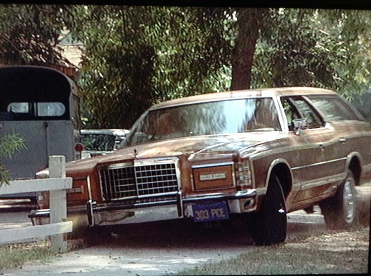 "A 1978 FORD LTD COUNTRY SQUIRE piloted by Barbara Harris plows through a neighborhood fence in ""The North Avenue Irregulars"" (1979)."