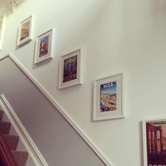 Vintage Travel Posters Framed Gallery Wall up the stairs
