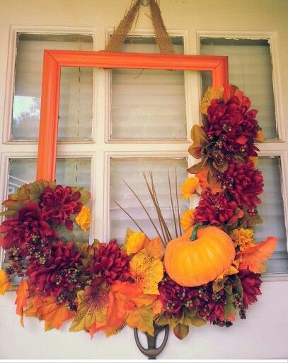 My Fall wreath. Dollar Tree project. Dollar Tree flowers, picture frame, and pumpkin. Hot glue together add a bow, Voila!