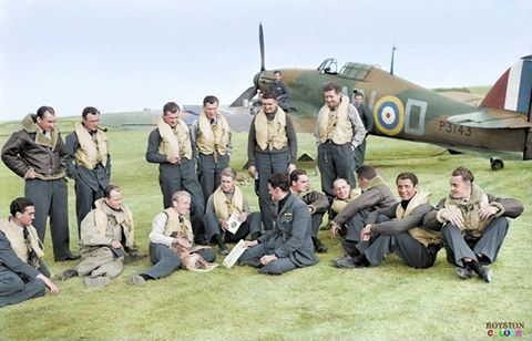 C: Czechoslovak pilots of No. 310 (Czechoslovak) Squadron RAF and their British flight commanders grouped in front of Hawker Hurricane Mark I, P3143 'NN-D', at Duxford, Cambridgeshire