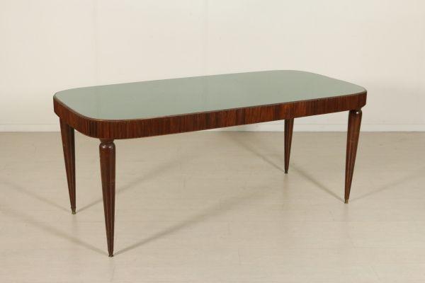 Tavolo; legno di faggio tinto e grissinatura, piano in vetro retro trattato. Buone condizioni, presenta piccoli segni di usura.