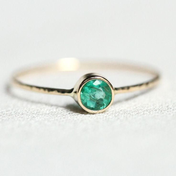 Emerald on a SOLID 14k Gold Sparkling Thread of White or Yellow Gold - Hammered Stacking Ring with Faceted 4mm Emerald - Delicate Jewelry by MARYJOHN on Etsy https://www.etsy.com/listing/186291607/emerald-on-a-solid-14k-gold-sparkling