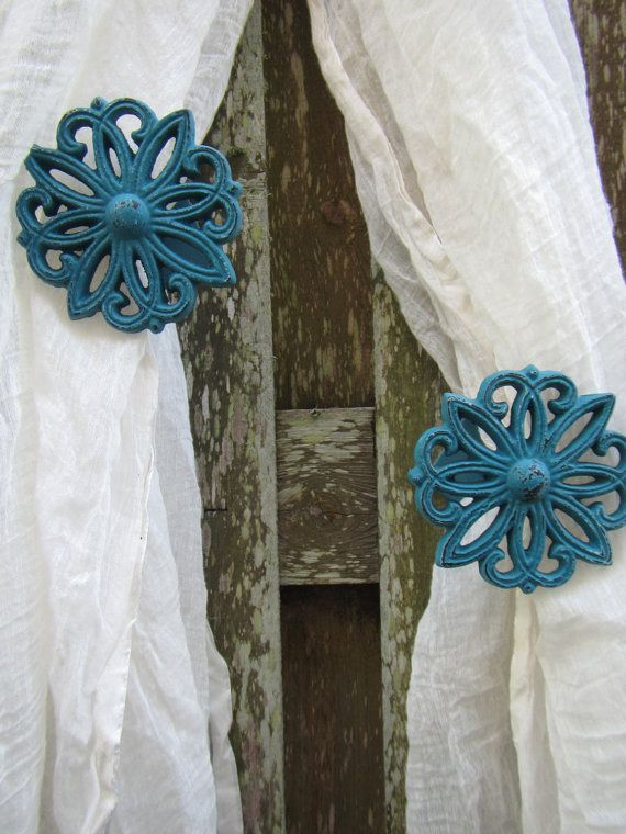 Is it curtain tie back or curtain tieback? At any rate This set of Shabby Chic drape holders will make a lovely final touch to your shabby or beach inspired home decor. Use in a bedroom, living room, nursery, or open air room to hold your drapes back in perfect fashion. This set is turquoise with a distressed finish but I am more than happy to create a pair to match your own decor. Each curtain tieback has been primed and painted before being carefully distressed and sealed for durability…