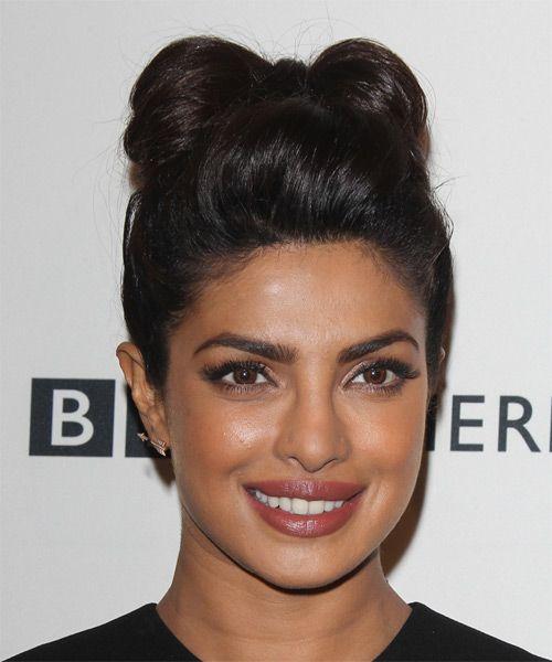 Priyanka Chopra fun bow-tie Updo. Try on this hairstyle! http://www.thehairstyler.com/hairstyles/formal/long/straight/priyanka-chopra