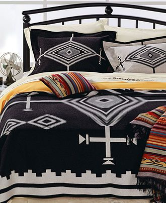 Add a dramatic touch to your space with this luxurious Los Ojos blanket. Features a mix of cross and diamond-shaped eye designs for a modern yet historical look. Reverses to a striking white pattern.