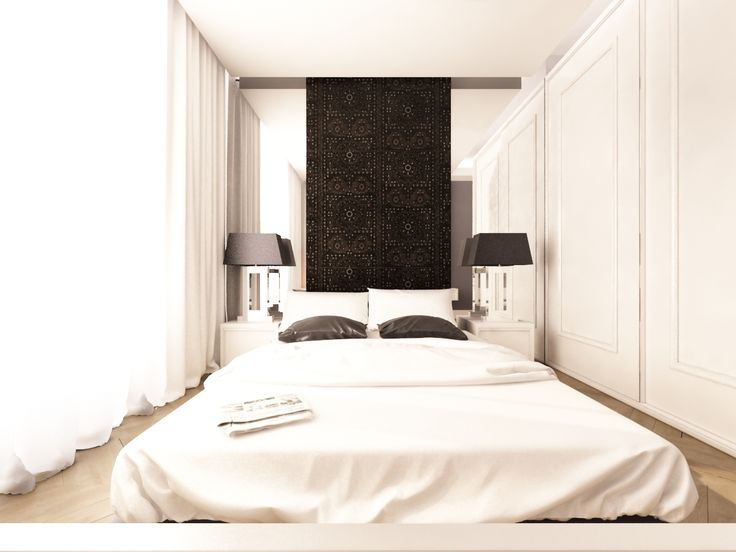 Sypialnia. Łózko  wieńczy wezgłowie  z czarną geometryczną tapetą .Symetryczne lustra nadają głębi pomieszczeniu