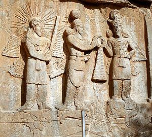 Investiture of Sassanid emperor Shapur II (center) with Mithra (left) and Ahura Mazda (right) at Taq-e Bostan, Iran.