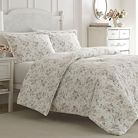 Turn in each night to the warm and cozy Rosalie Duvet Cover Set from Laura Ashley. Boasting a soft and snug cotton flannel construction, this luxurious ensemble boasts a delicate rose print that brings a stylish update to your bedroom décor.