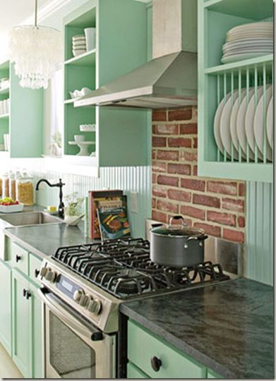.I love open shelving in the kitchen. I really like the wooden dowels making a dish rack and green is my favorite color. I love everything about this look.