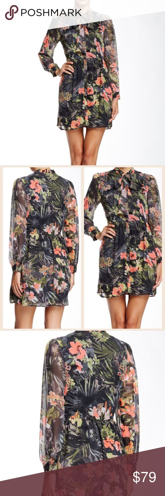 Tropical dress by W118 by Walter Baker Gorgeous tropical dress with tie at neck. Front buttons up. Very flowy fabric. Brand new with tag. W118 by Walter Baker Dresses