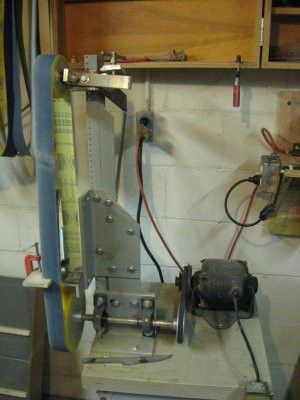 Belt Sander by Dave Tenney -- Homemade belt sander constructed from a surplus washing machine motor, a computer rack, and commercial contact wheels and shafting.  http://www.homemadetools.net/homemade-belt-sander-22