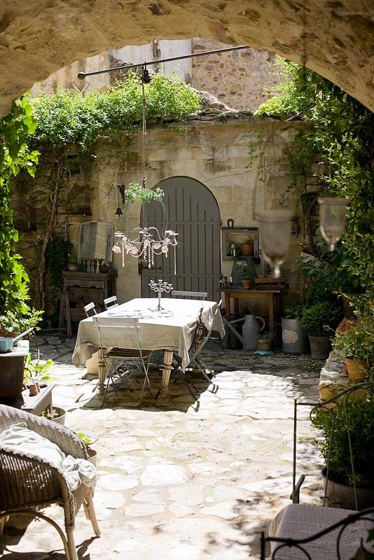 Tuscan tradition. I am seriously loving the grey/khaki colors of natural stone/pebbles + the vibrant green of plants. this helps me feel so much better about our mud hole of a yard. i think we can transform the pit into beauty.