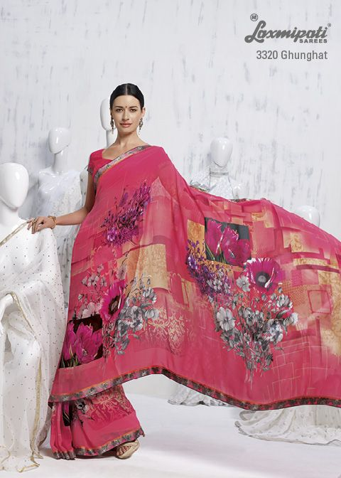 Different amazing floral prints on peach background enhance the saree's beauty.