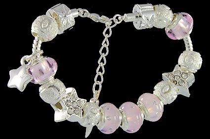 silver plated items: bracelet with lobster, star beads with cubic zirconia, balls, star charm, locks. Five glass beads with 925 silver core and cubic zirconia.