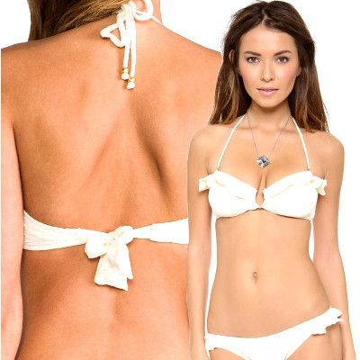 A  gold U-ring adorns the front of this stunning Eberjey El Mirage Mimi Bandeau Top. The gold beads which dangle from the optional halter strap, add a subtle hint of luxury. the Eberjey Mimi top offers side boning and removable padding provide lift and support for any body type.  Shell: 57% nylon/28% elastane/15% polyester. Lining: 90% nylon/10% elastane.  Optional halter strap provided #eberjey #bikini #stringbikini