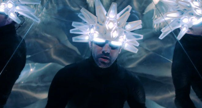 "Jamiroquai Returns With Futuristic Music Video For 'Automaton' After 7 years of silence, Jamiroquai released a music video for a brand new single entitled ""Automaton."" In the post-apocalyptic futuristic video, frontman Jay Kay can be seen wearing a luminous robotic headpiece while exploring what remains of London after a nuclear explosion."