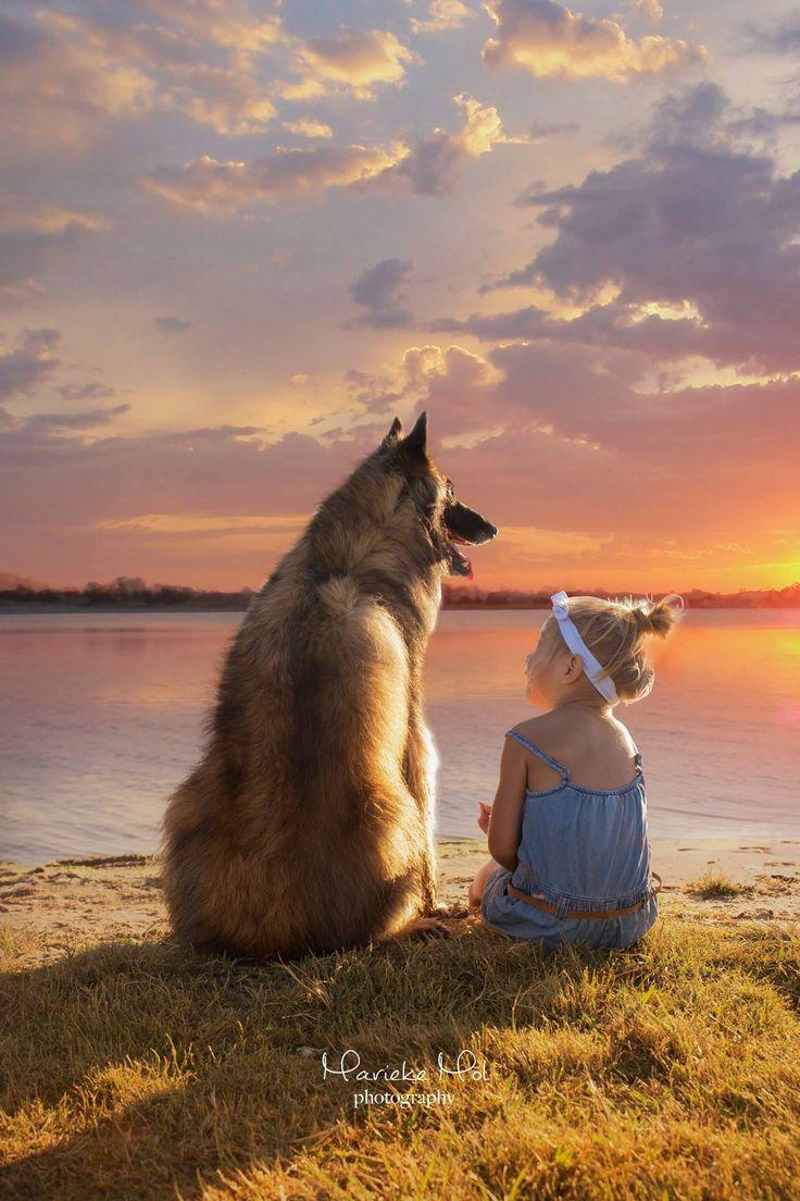 Girl and dog at sunset.