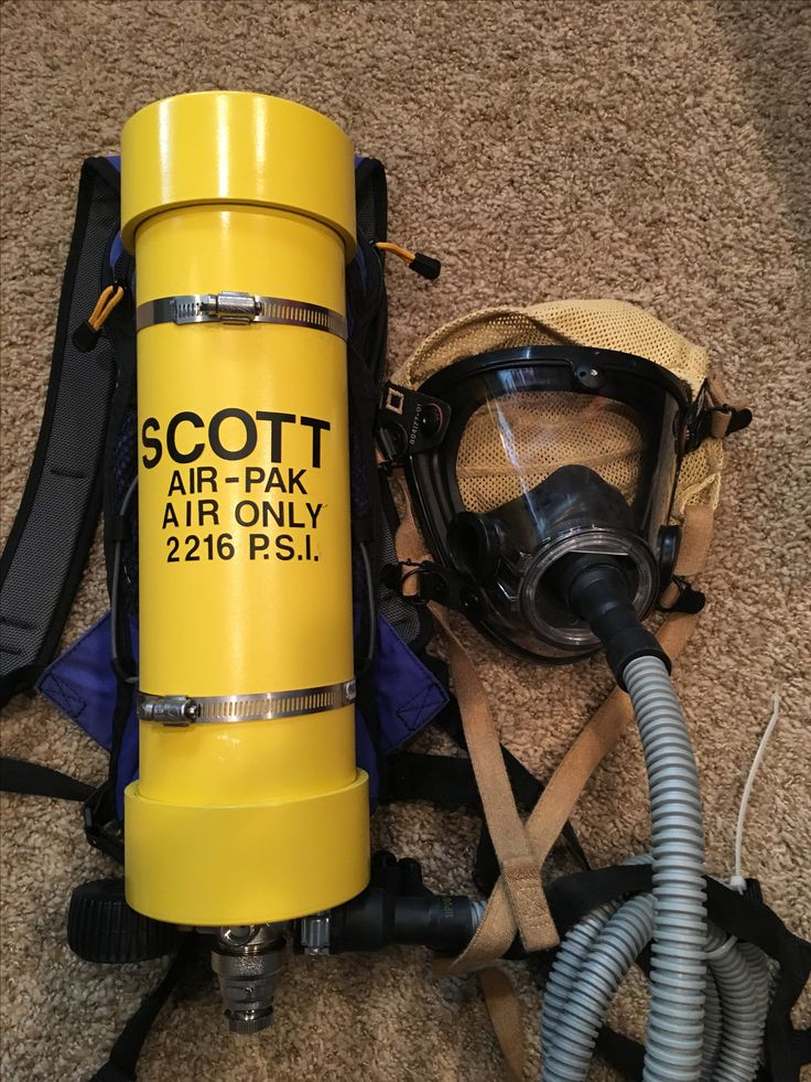 """DIY fireman's air tank for my little firefighter. Easy 4"""" PVC pipe painted and attached to an old camelback backpack and an old beer regulator plus a dishwasher hose. Air mask given to us by a fire department."""