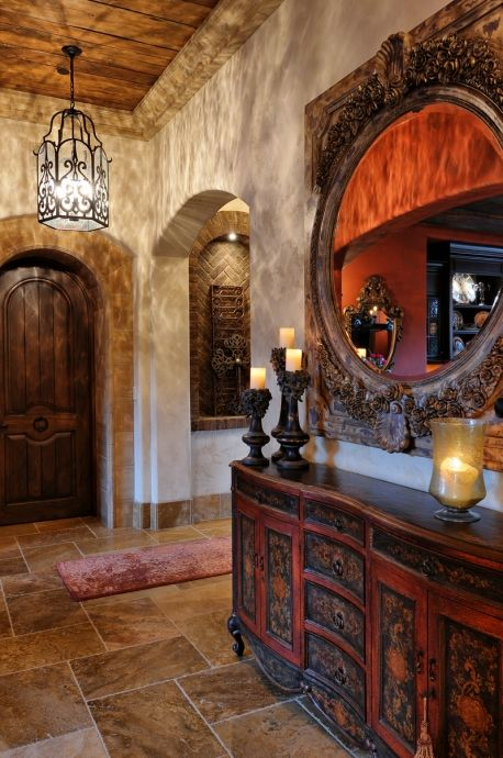 All earth tones.  Passageway arches with border and without.   Rustic board ceiling?  Crown moulding is interestin`g