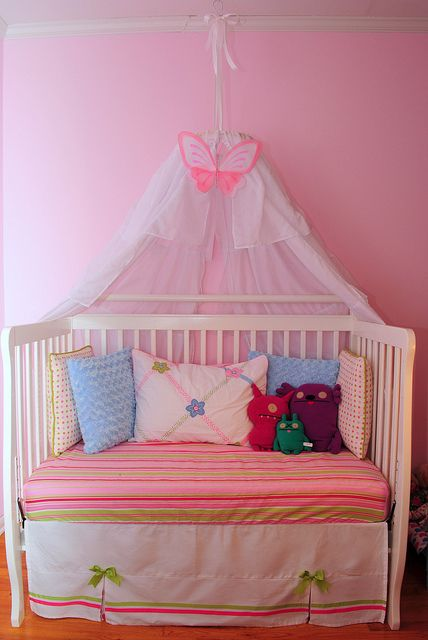 repurposed crib to reading nook