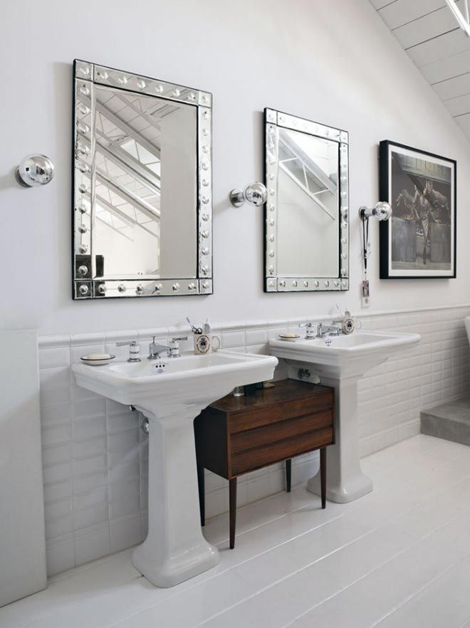I really like the idea of two pedestal sinks with a piece of furniture in between.