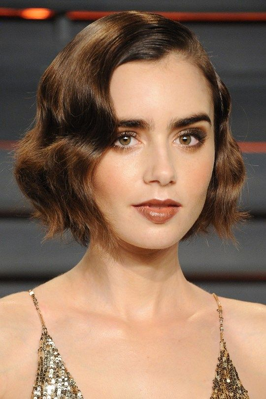 Red carpet hairstyle. curly retro bob - Lily Collins. Celebrity Hairstyle. The Oscars 2016