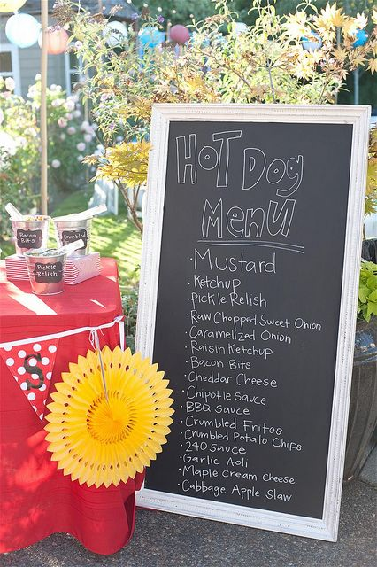 Cookout set up a hot dog bar with toppings host a casual cookout