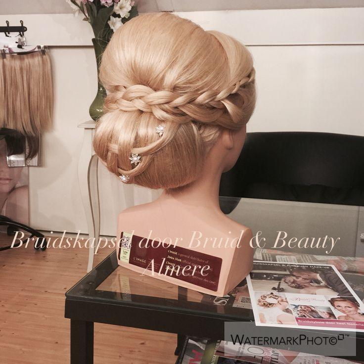 Bridal hair updo  Bruidskapsel lage knot met vlecht.