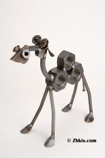 Camel Sculpture Handcrafted from metal scrap parts this camel is adorable as he looks up with his glass eyes. This wonderful sculpture is made in the USA. Each piece is handmade and will vary slightly from piece to piece