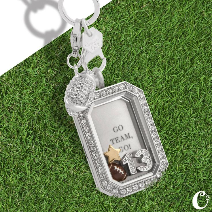 I love this locket! Must have for any sports mom! This one is football but I plan to get one for my son for basketball and baseball. Use the same plate just change out the dangle, charms and numbers! www.locketswithchelle.origamiowl.com I am a baseball mom and basketball mom and I need this!