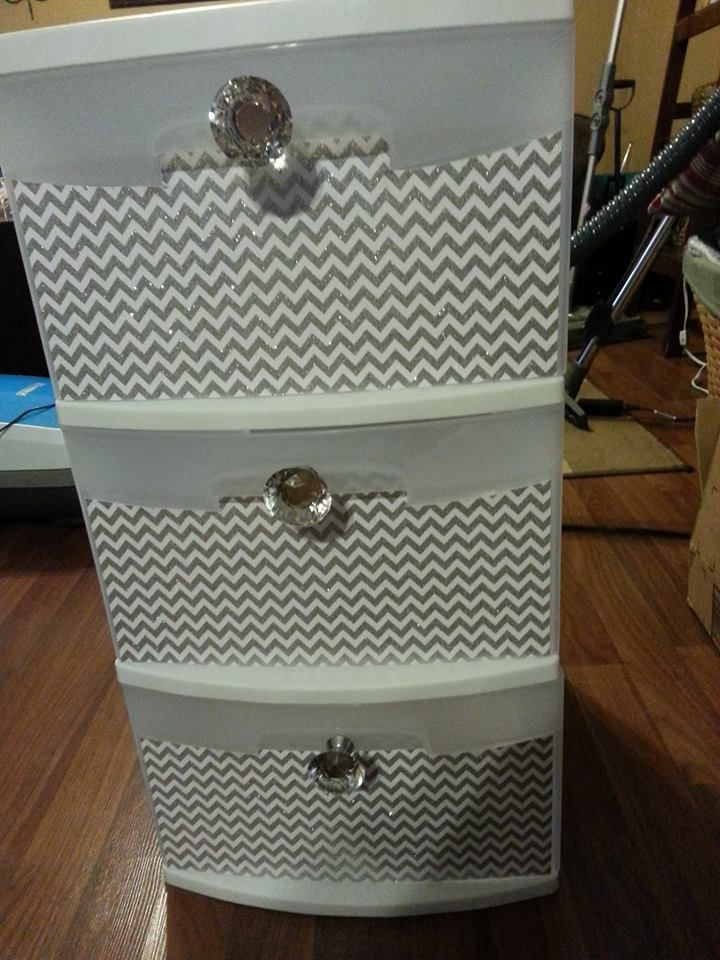 Sterilite storage drawer makeover. Some scrapbook paper, modge podge, and some fancy knobs.