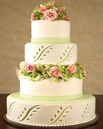 Pink and green on white cake with cutouts  CAKE ONE HUNDRED SEVENTY EIGHT, Wedding Cakes by Dawna, LLC