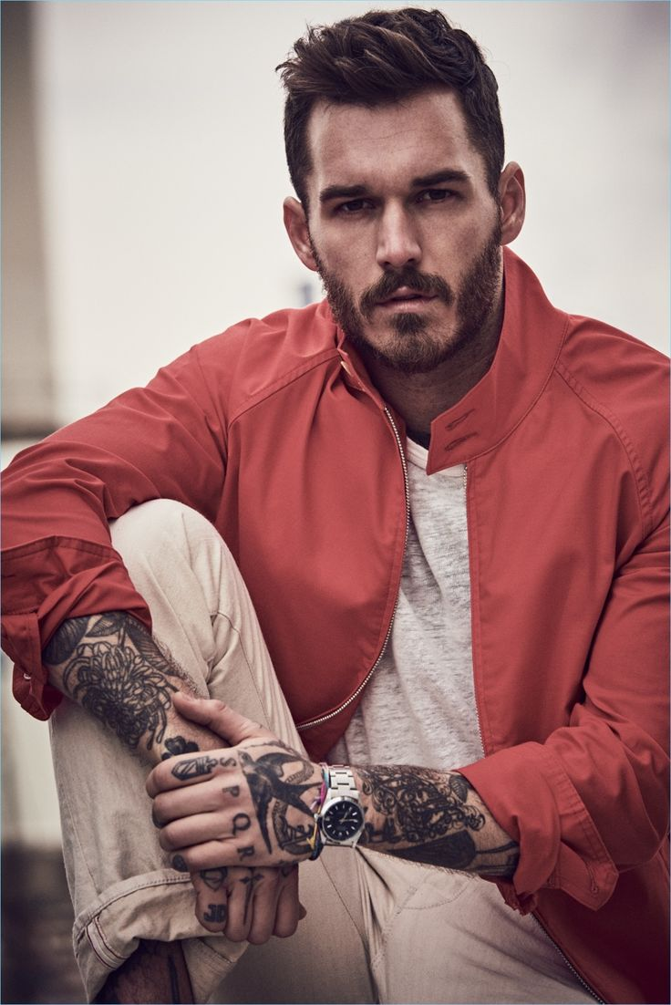 David Alexander Flinn wears a red Harrington jacket $328 from Todd Snyder's Champion collaboration. The tattooed model also sports a pocket tee $78 and selvedge birch rinse jeans $198.