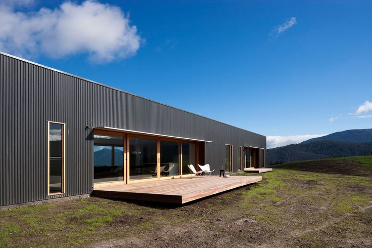 Architects of Doherty Lynch studio have designed this modern farmhouse 'Finnon Glen' near the reservation Healesville in Victoria, Australia. The original building was completely destroyed by a large fire and the owner wanted to have a new house with simplicity, spaciousness and modern look, without going beyond the
