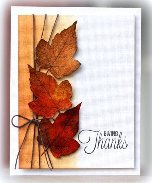 handmade Thanksgiving card from Rapport från ett skrivbord ... three realistic die cut leaves  in rich Autumn browns ...a  triple wrap of brown twine ... a bit of sponged rustie color along the side ... a lovely card ...